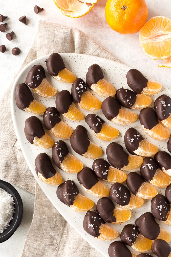 chocolate covered orange slices on a plate