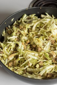uncooked cabbage in a pan with beef stir fry