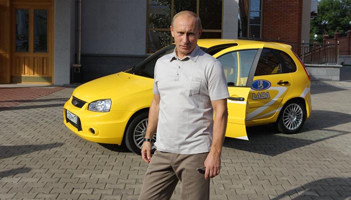 Putin standing next to a Lada Kalina