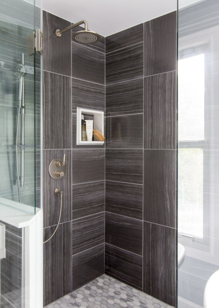 Master ensuite bathroom shower with dark tile