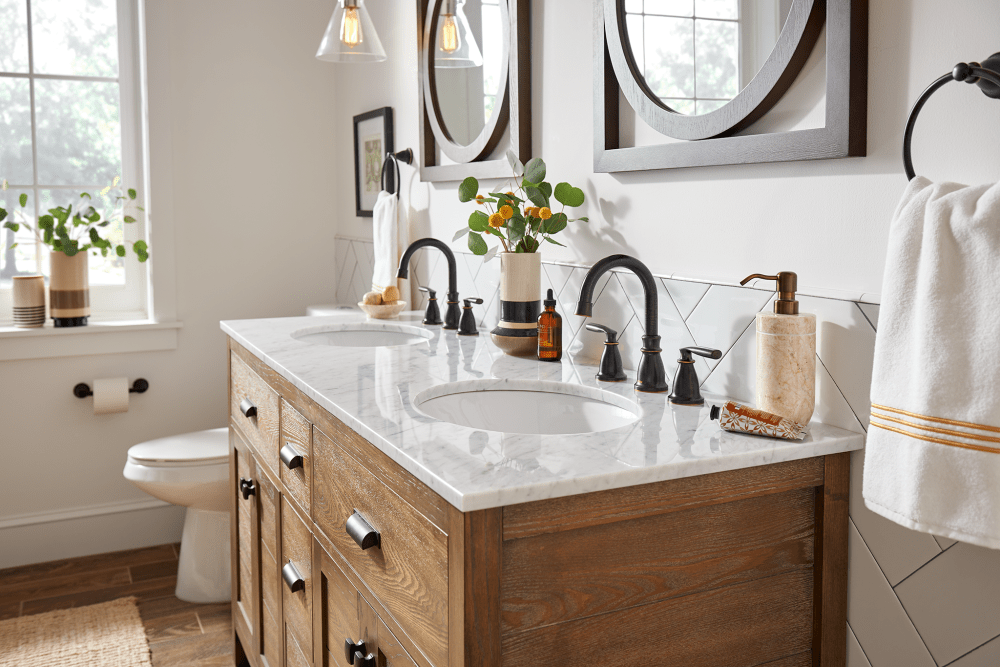 Bathroom with two sinks and oil rubbed bronze faucets