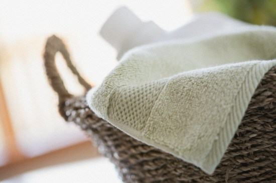 Close-up of clean towel in wicker basket.