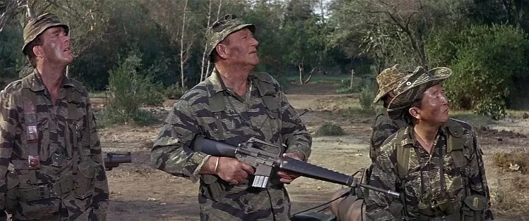 John Wayne in the 1968 film The Green Berets, the only Vietnam War film to have the support of the U.S. military. Wayne and the Jim Hutton can be seen wearing one variation of tigerstripe while the actors playing the ARVN soldiers are wearing another type. Such differences were actually common in Vietnam. (Photo: IMFDB/Public Domain)