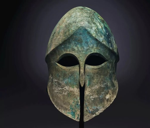 An ancient bronze Corinthian helmet.