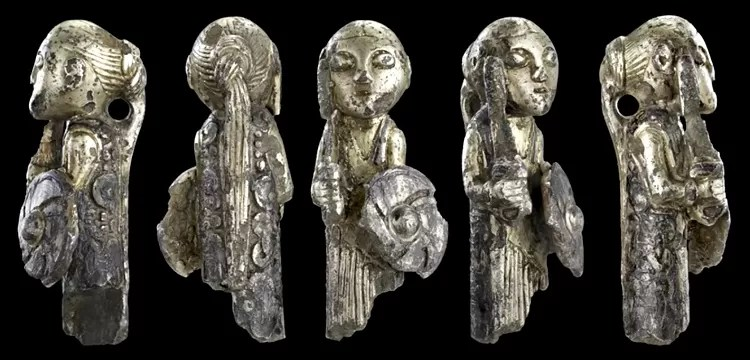 Viking artifact, sculpture of shield maiden with sword and shield