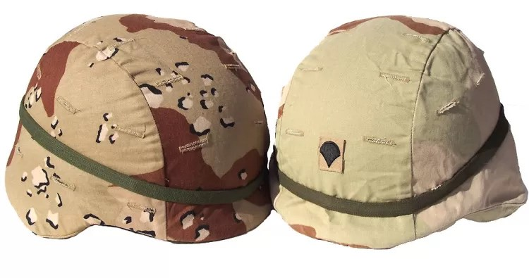 "A pair of U.S. PAGST helmets with desert covers – on the left is the Desert Battle Dress Uniform (DBDU), which earned the nickname ""chocolate chip;"" and the BDU on the right."