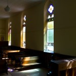 At a certain time of day, the stained glass projects perfectly on the aisles