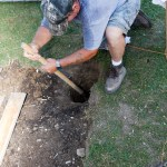 Rob hand digging the bathroom footings.