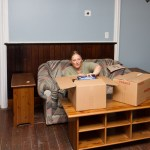 Leah unpacks some living room goodies.