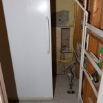 The spare fridge in the newly tiled utility room.