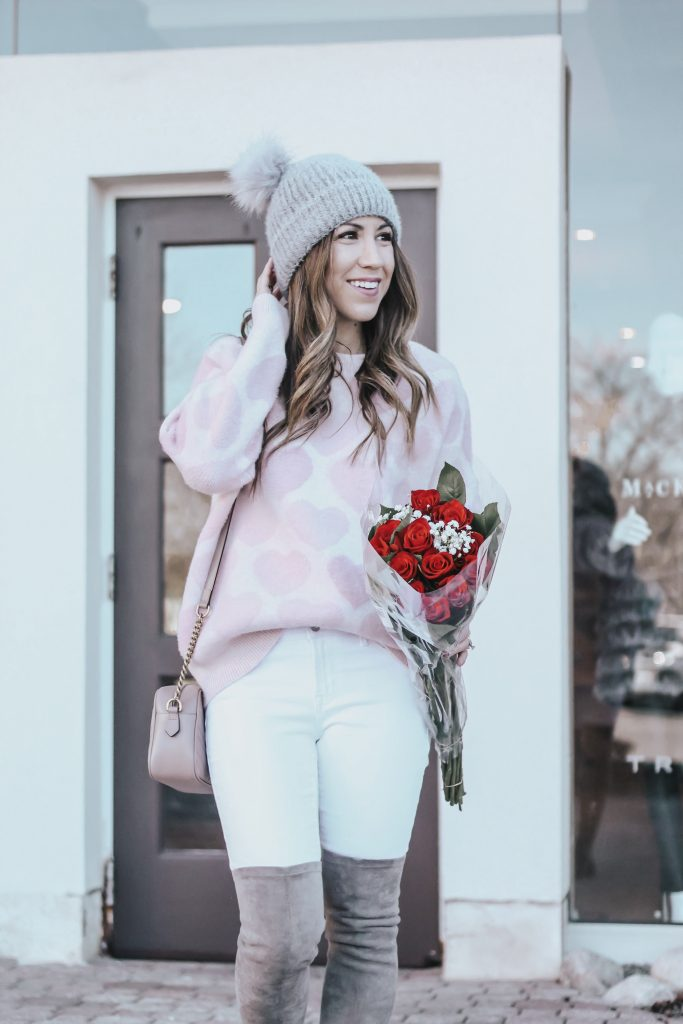 Cute Valentine's Day Sweaters featured by top US fashion blog House of Leo Blog; Image of a woman wearing Chicwish sweater, Old Navy jeans and Goodnight Macaroon boots.