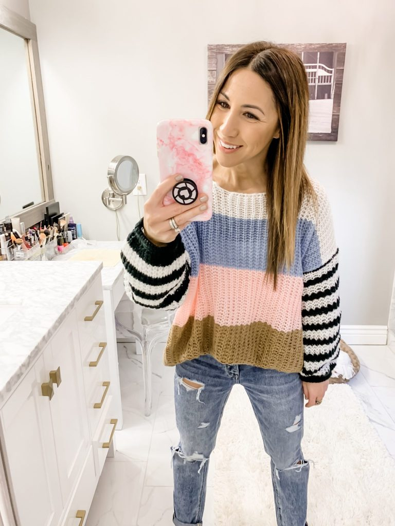 SheIn Haul by top US fashion blog, House of Leo Blog: image of a woman wearing a colorblock sweater and American Eagle tomgirl jeans
