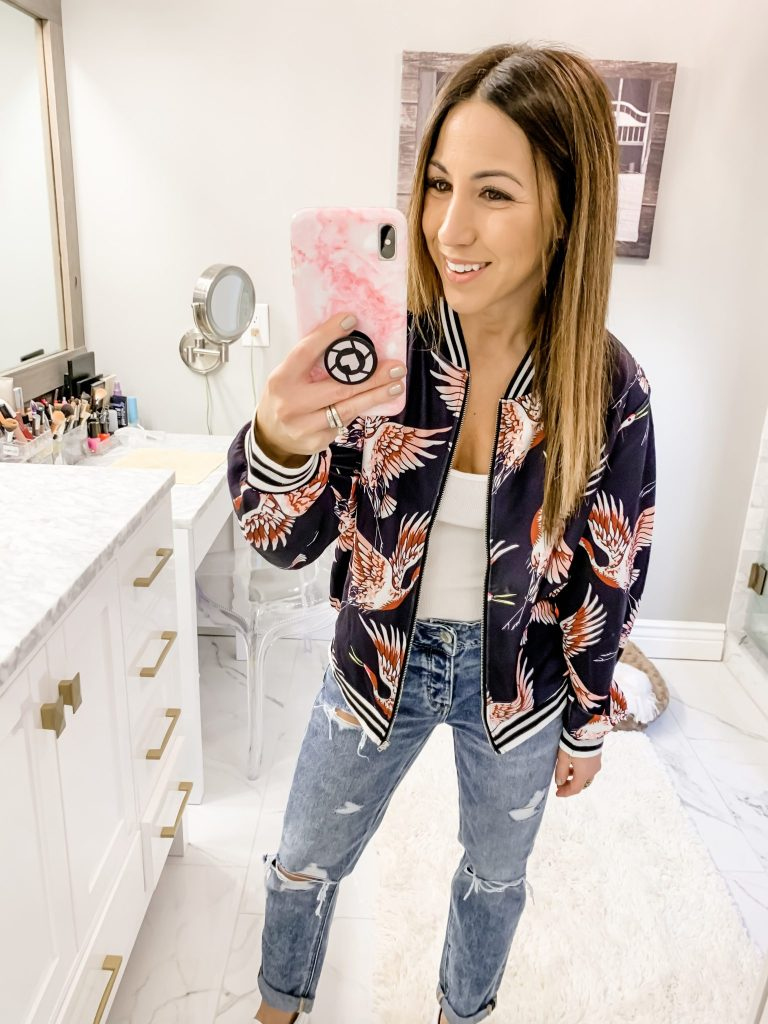 SheIn Haul by top US fashion blog, House of Leo Blog: image of a woman wearing a printed crane bomber jacket and American Eagle tomgirl jeans