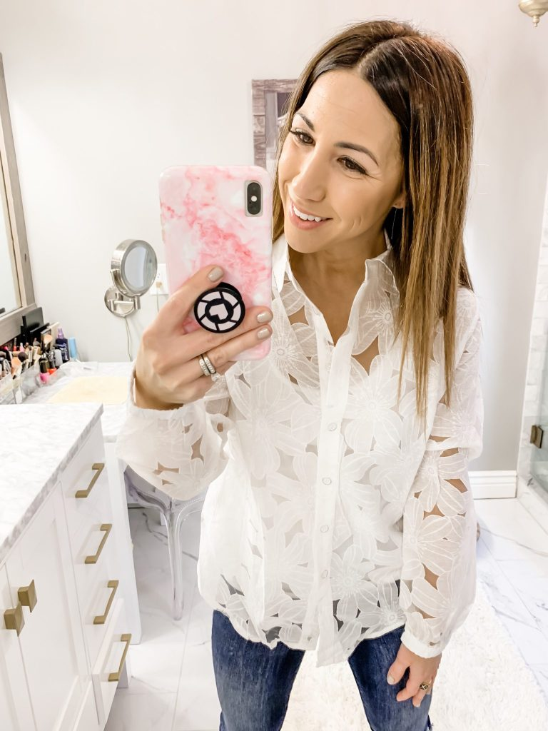 SheIn Haul by top US fashion blog, House of Leo Blog: image of a woman wearing a white floral button down shirt and American Eagle tomgirl jeans