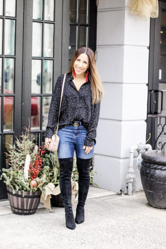 SheIn Haul by top US fashion blog, House of Leo Blog: image of a woman wearing a black polka dot blouse and over the knee boots from Goodnight Macaroon