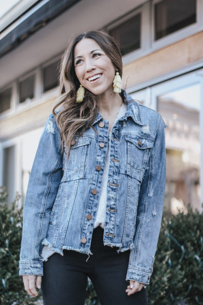 The Best Sale Items at Evereve by top US fashion blog, House of Leo Blog: image of a woman wearing a distressed denim jacket by BlankNYC