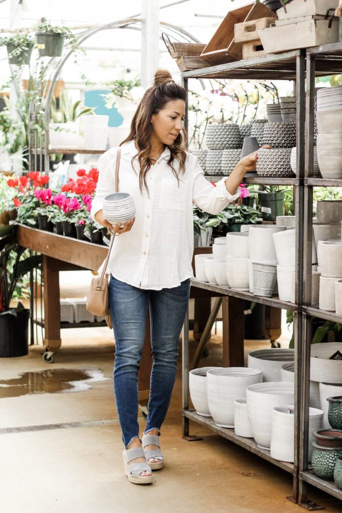 Closet Staples from Evereve by top US fashion blog, House of Leo Blog: image of woman wearing a white button down top, Kut from the Kloth jeans, Kenneth Cole espadrille wedges from Evereve