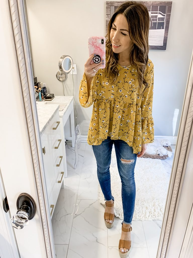 SheIn Haul by top US fashion blog, House of Leo Blog: image of woman wearing Fluted Sleeve Calico Print Dip Hem Top