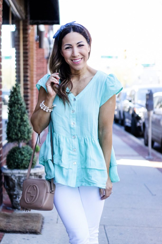 Cute Spring Outfits from Red Dress Boutique by top US fashion blog, House of Leo Blog: image of woman wearing a green linen top and white jeans