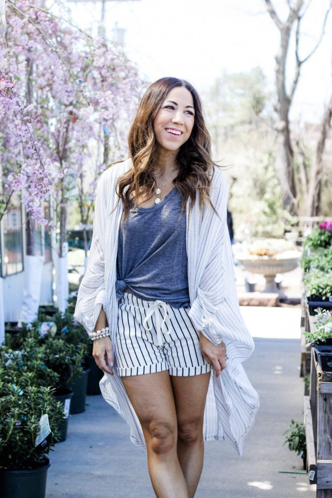 Top 10 Evereve Favorites for Spring by top US fashion blog, House of Leo Blog: image of woman wearing Free People kimono, ZSupply shorts
