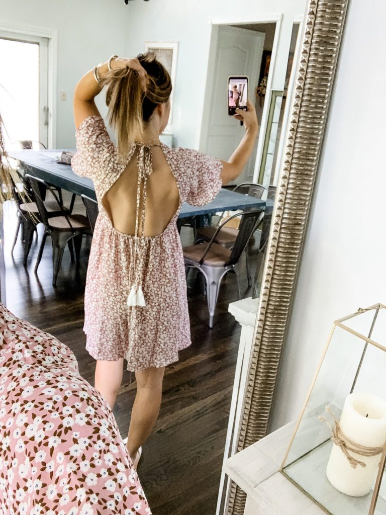 SheIn Haul by top US fashion blog, House of Leo Blog: image of woman wearing FLORAL TASSEL KNOT BACKLESS BUTTON FRONT TEA DRESS