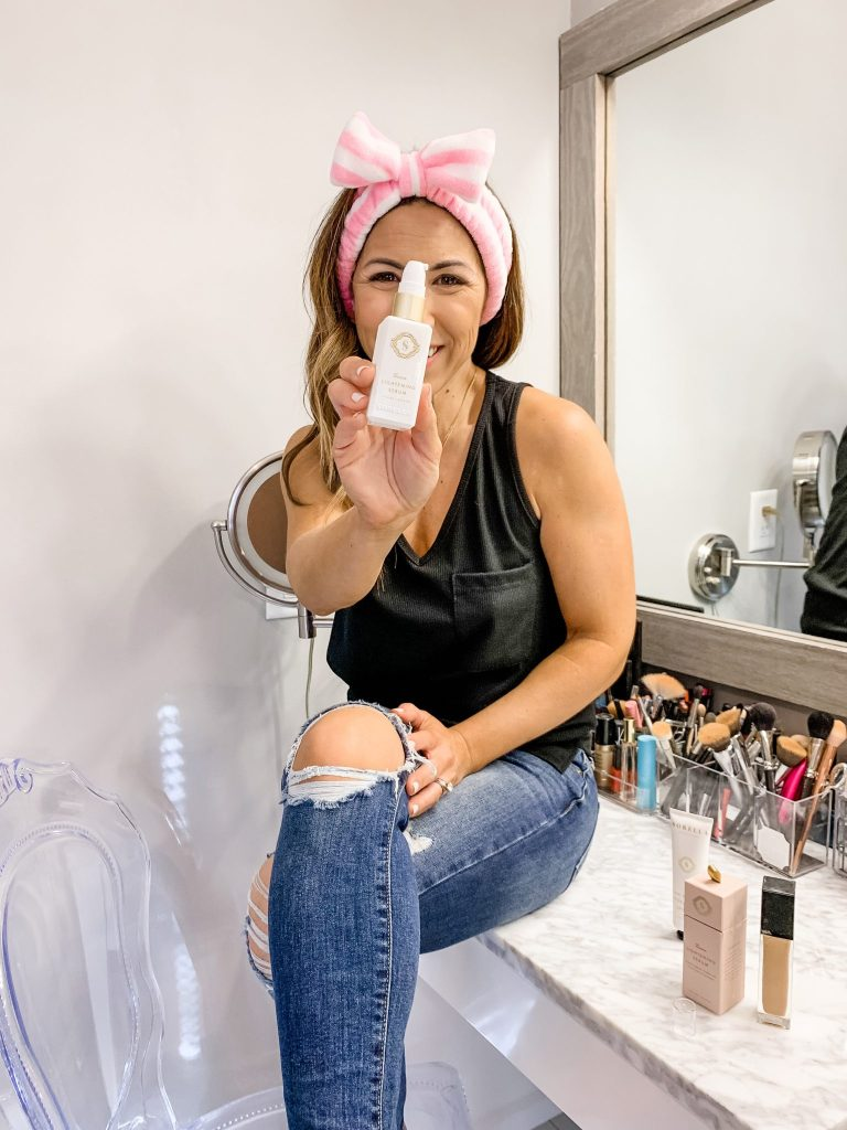 2 Must Have Skincare Products For Summer by top US beauty blog, House of Leo Blog: image of woman using Art of Skin Sorella Apothecary Lemon Lightening Serum