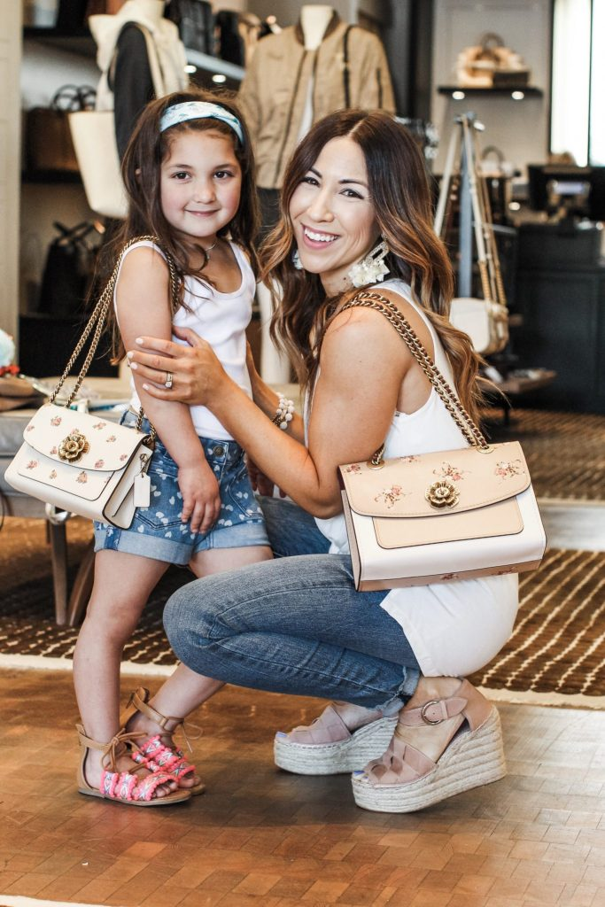 Where I shop at the Grove for Mother's day by top US fashion blog, House of Leo Blog: image of woman shopping at Coach at the Grove, Shrewsbury, NJ