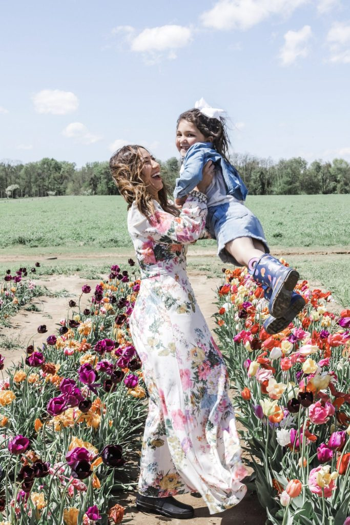 2 Year Blogiversary: 5 Top Tips on How to Grow Your Blog in a Couple of Years by top US fashion blog, House of Leo Blog: image of woman and child at Holland Ridge Tulip Farm wearing a floral Chicwish dress