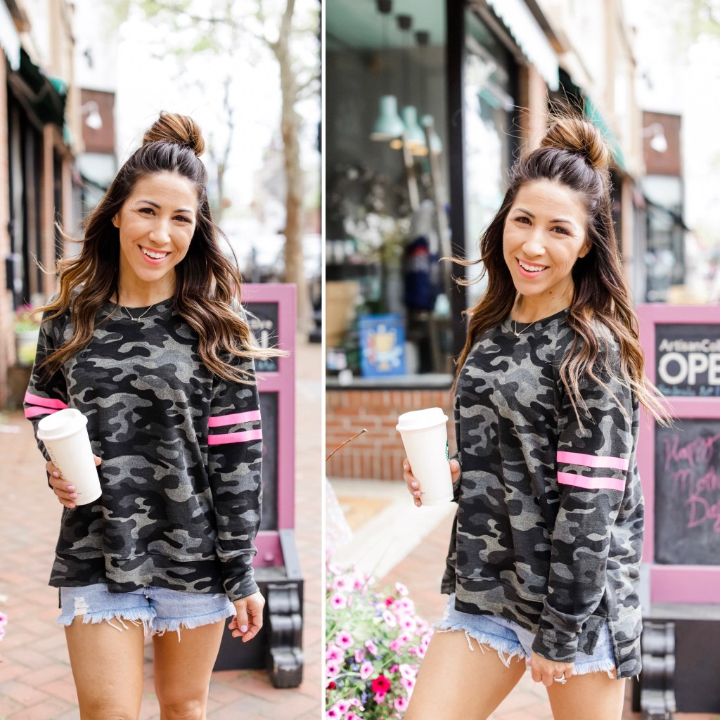 Summer Style With Evereve by top US fashion blog, House of Leo Blog: image of woman wearing Sundry camo sweatshirt, Agolde parker denim shorts, white classic Vans