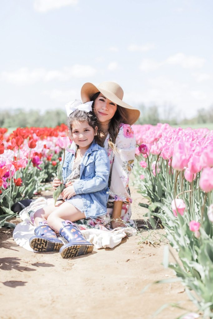 2 Year Blogiversary: 5 Top Tips on How to Grow Your Blog in a Couple of Years by top US fashion blog, House of Leo Blog: image of woman and child at Holland Ridge Tulip Farm wearing a floral Chicwish dress and straw hat