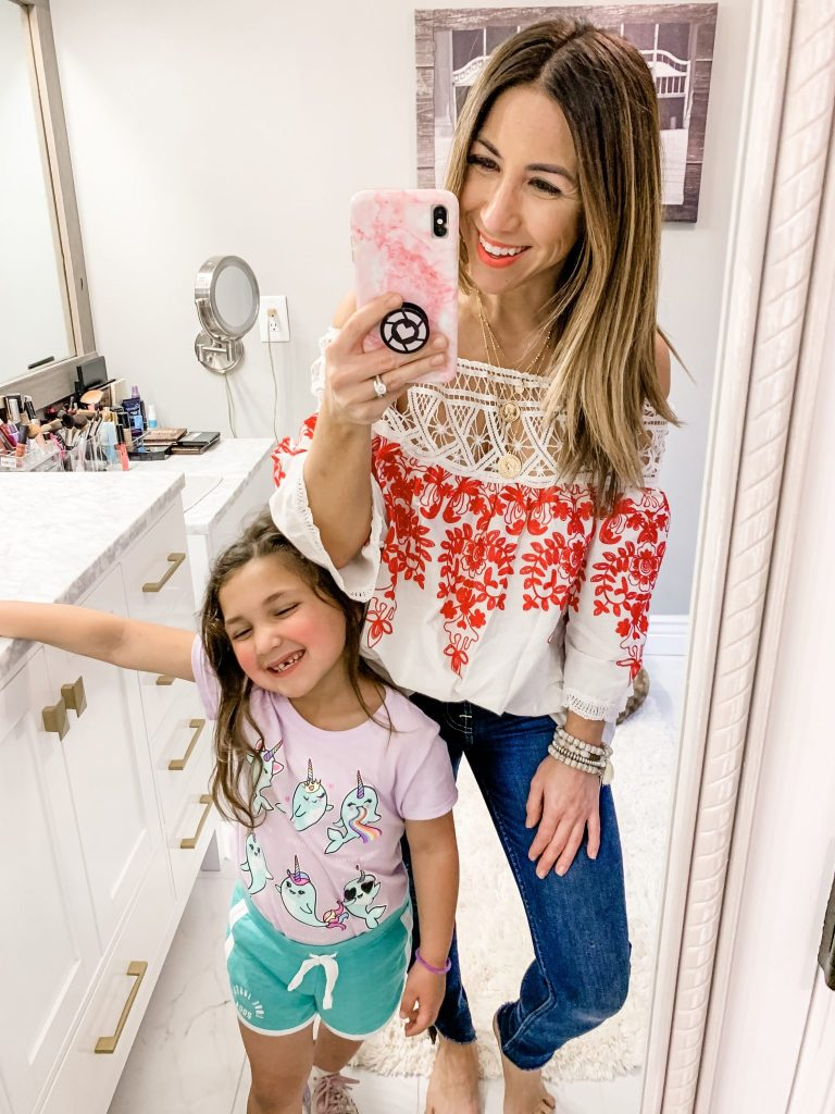 Amazon Haul by top US fashion blog, House of Leo Blog: image of woman wearing Romwe Cold Shoulder Floral Embroidered Lace Scalloped Hem Blouse