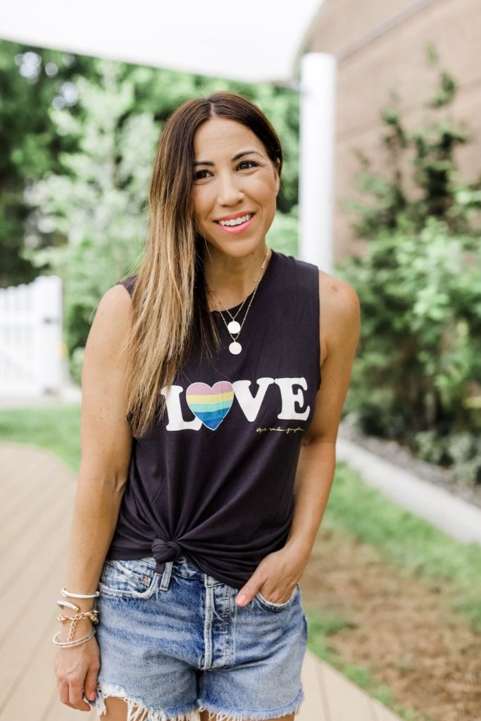Evereve 4th of July Sale by top US fashion blog, House of Leo Blog: image of woman wearing agolde denim shorts, LOVE graphic tank, steven greece slides