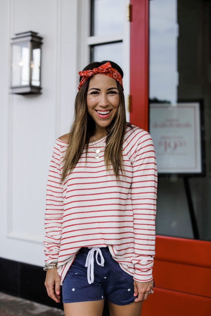 Evereve 4th of July Sale by top US fashion blog, House of Leo Blog: image of woman wearing red and white striped sweater and zsupply star shorts