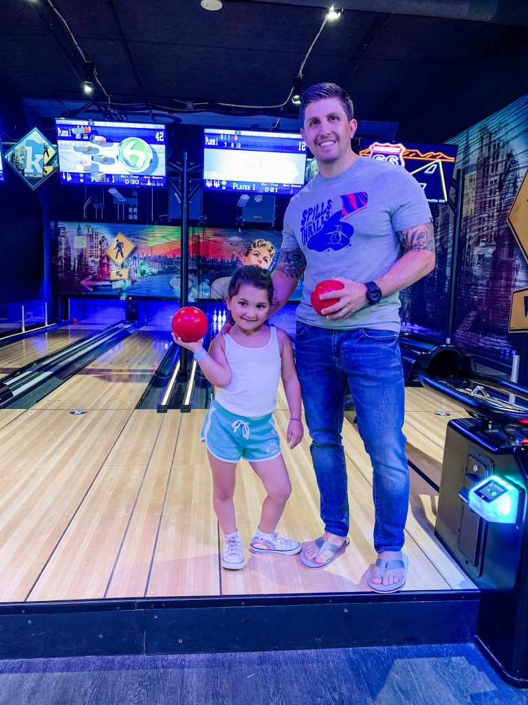 The Kartrite Resort Review by top US lifestyle blog, House of Leo Blog: image of father and daughter at Kartrite bowling alley