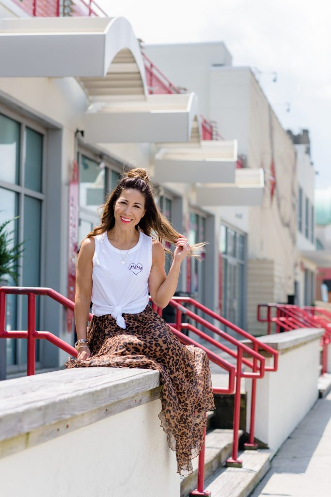 The Best Leopard Pieces for Summer by top US fashion blog, House of Leo Blog: image of woman wearing Chicwish leopard skirt, Mama tank, and Rex leopard espadrilles by Marc Fisher