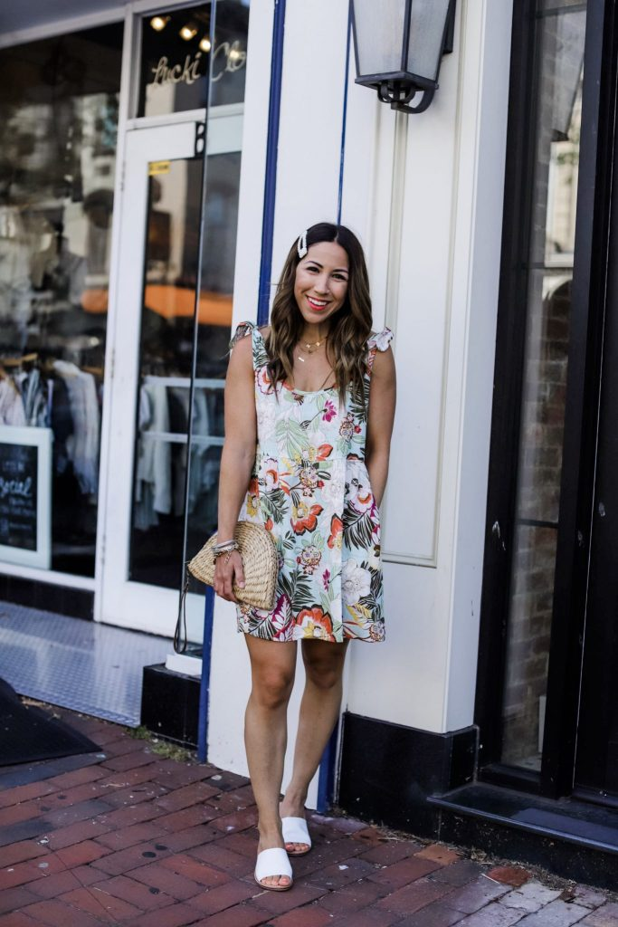 5 Simple Summer Looks from Red Dress Boutique by top US fashion blog, House of Leo Blog: image of woman wearing short palm print, paisley dress and white slide sandals