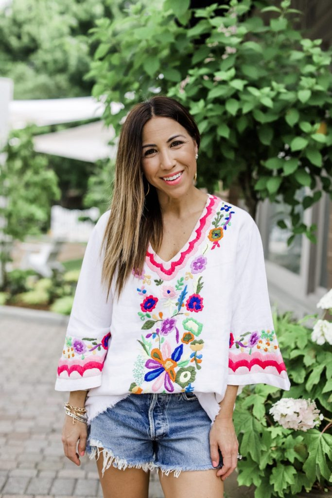 3 Gorgeous Pieces From Paulita Carlotta by top US fashion blog, House of Leo Blog: image of woman wearing embroidered tunic