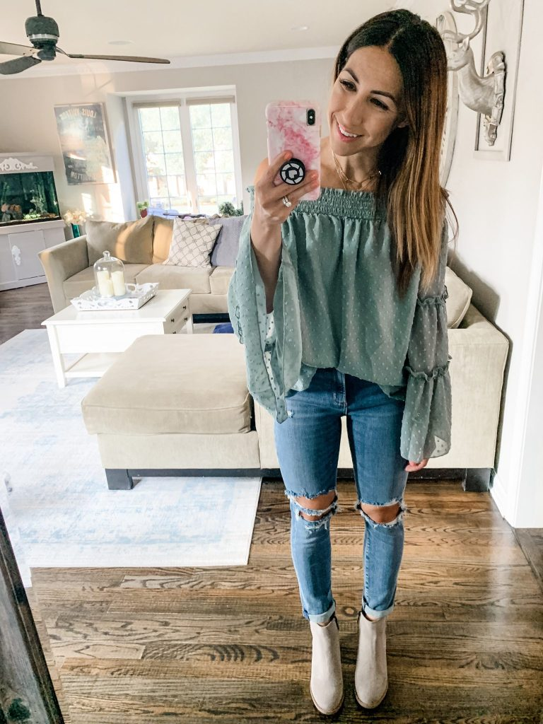 Amazon Haul July by top US fashion blog, House of Leo Blog: image of woman wearing off the shoulder sage green chiffon polka dot blouse, Agolde Sophie crop jeans