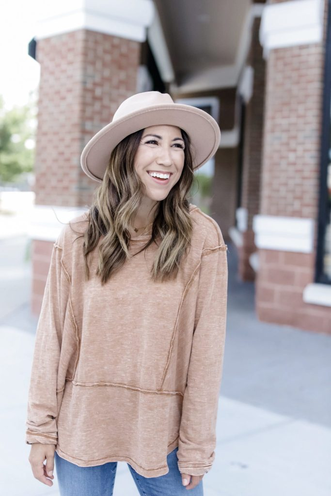 The Best Weekend Wear From Z SUPPLY by top US fashion blog, House of Leo Blog: image of woman wearing orange airy slub, brown fedora hat