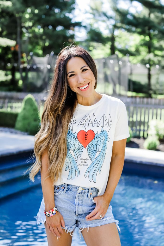 The Evereve 2020 Pass by top US fashion blog, House of Leo Blog: image of woman wearing white def leppard tee and agolde parker shorts