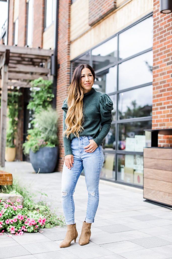 September Finds From Express by top US fashion blog, House of Leo Blog: September finds from Express, image of woman wearing hunter green puff sleeve turtleneck sweater, blue high waisted skinny jeans