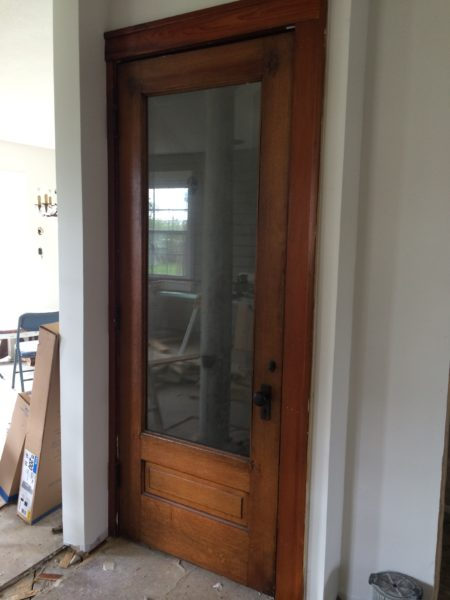Basement door with faux antique mirror - House on Winchester