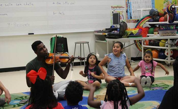 Children learn from Houston Symphony musicians during the Camp Adventure summer program.