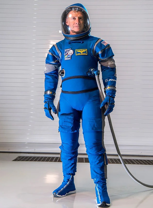 Bright blue fitting Boeing suit