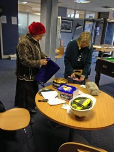 Beatrice and Mary unpacking their woolly hats - over 70 of them!