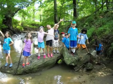 Campers from Howard County Conservancy's Summer Nature Camp at Mt. Pleasant across the Davis Branch stream