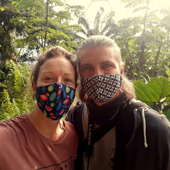 Van lifers How and Bev Askew with covid masks in the palm house at the Eden Project