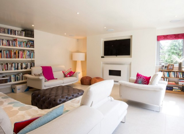 Elegant White Sofas with Pink Cushions Brown Table