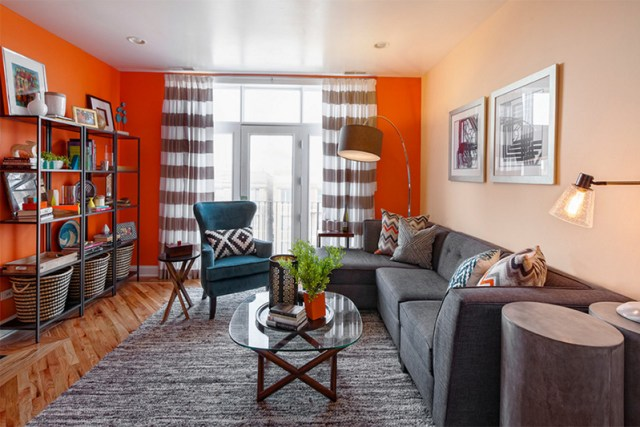 dark grey sofa living room with orange wall