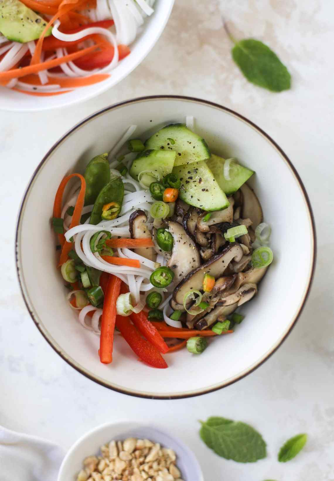 Ginger scallion noodle bowls are a flavorful, comforting vegetarian meal that can be customized to include any veggies you love! I howsweeteats.com #noodle #bowls